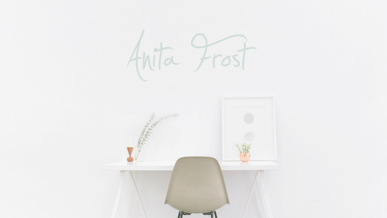 Picture of a desk with Anita Frost logo on